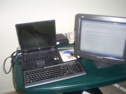 A picture of a the monitor, keyboard, and mouse that are hooked up to my laptop.