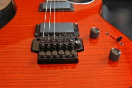 A picture of the Godin Redline 3, equipped with 2 EMG's and a Floyd Rose Original.