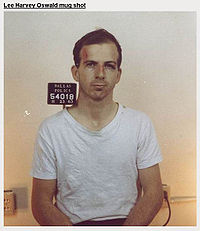 "Oswald's mug shot the day of arrest. He told reporters the scrape above his left eye was because ""a policeman hit me."""