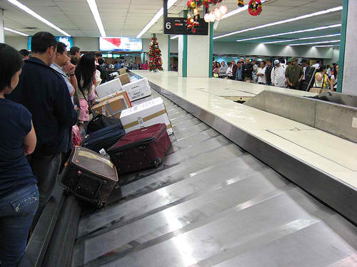 Searching for my Balikbayan Box at the conveyor belt area of the airport