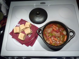 Vegetable soup started on the stove top, then transferred to the oven in the same La Chamba pot and onto the table for serving.