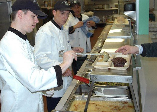 More US Navy feeding homeless at a Mission as part of an outreach program.