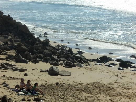 - Sun Bathing in January on a secluded Huntington Beach Cove -