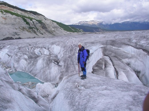 High up the melting glacier I am in the midst of deep crevasses and pools of blue green water.
