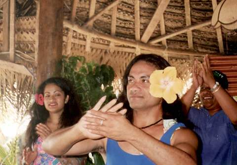 A fakaleiti dancing with pretty flower in hair.