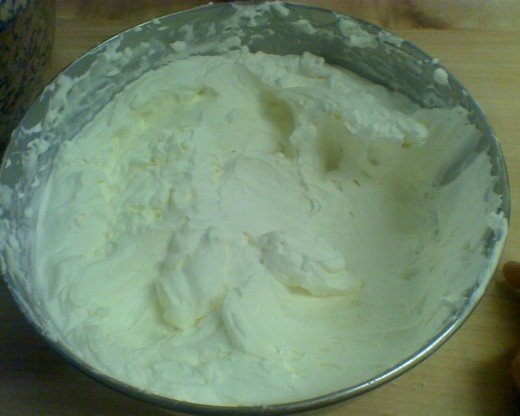 Big bowl of whipped cream for an extra light and creamy dessert