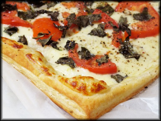 Delicious mouth-watering pizza with mozzarella, basil, and tomato on a flaky puff-pastry crust! Great as an appetizer or entree!