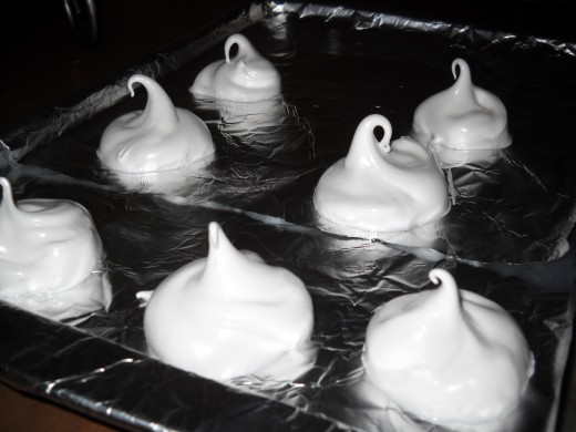 Meringues, cookies going into the oven at low heat