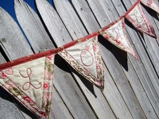"Quilted ""love"" bunting - photo by Moda Bake Shop"