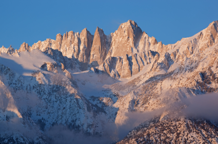 Mount Whitney is the tallest peak in the middle of the photo, with the Moutaineers Route in the shadow to the right of the summit.