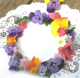 Delicate flowers from the garden form this wreath for pennies.