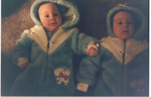 Twins in identical snowsuits