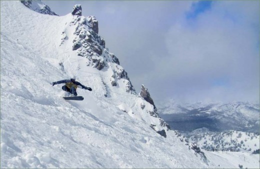 This is a picture of snowboarding down a mountain. It takes a lot of carving skill so you can maintain control while going down steep slopes. This picture was taken on Mammoth Mountain, USA.