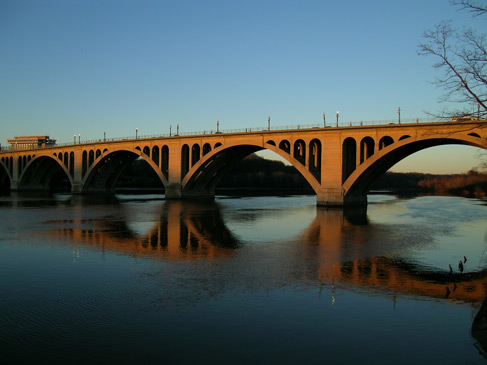 Key Bridge (Francis Scott Key Bridge), a six-lane reinforced concrete arch bridge connecting Arlington County, Virginia with the Georgetown neighborhood of Washington, DC.