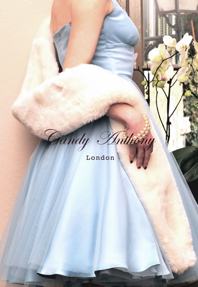Powder Blue Marylin gown with a frothy tulle overlay worn with an engagingly light faux fur stole in White Wolf, just daring to be stroked...