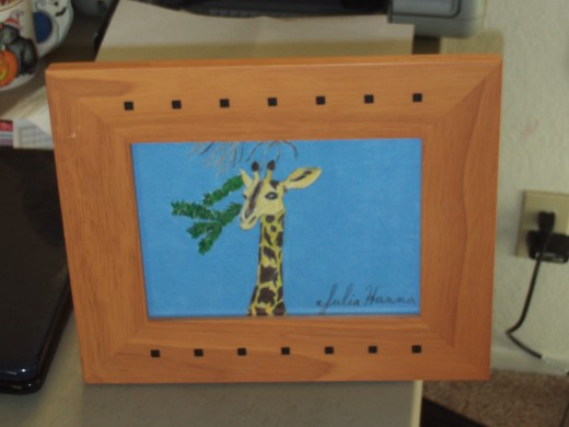 Framed picture of my giraffe drawing.  I am going to hang this vibrant illustration on my wall.