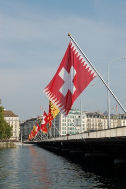 The Mont Blanc Bridge at Geneva, and a flag display: Swiss and Genevan flags alternate