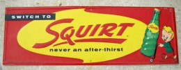 A tin Squirt sign from 1958