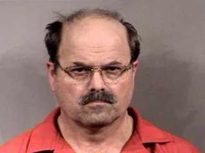 This photo of Dennis Rader after he was arrested was published in the Wichita newspaper, splashed all over Wichita TV stations, and appears profusely on the WWW. It has almost become an icon for BTK