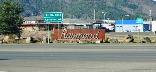 Entrance sign to Raymond from Hwy 6.