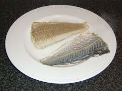 Skin cleanly removed from a pan fried coley fillet