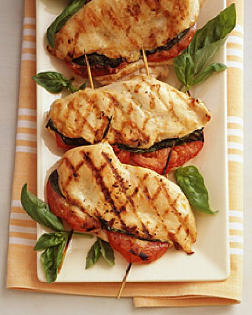 Grilled Chicken stuffed with basil and tomato.