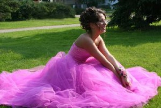 Amazon Prom Dresses - a picture of a beautiful, happy girl in a Pink Prom Dress in the green grass