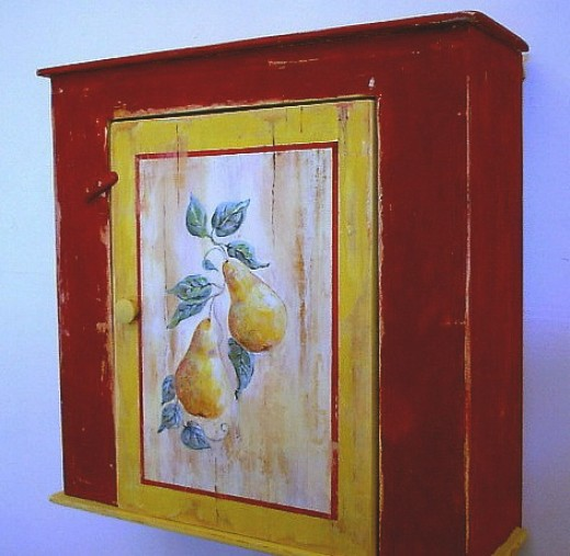 Rugged old wall cabinet, painted barn red and distressed to make it look even older.