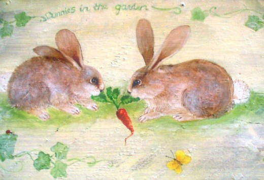 Bunnies in a tug of war on an old garden bench.
