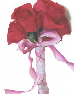 Very practical. 8 big red roses tied with ribbon and rhinestones.