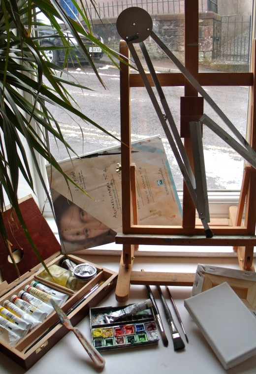 A selection of equipment that might be useful. Sketchpad, small oil paint feild kit, small watercolour kit with a tube of goache, 2 mini canvases and two easels - wooden tabletop and aluminium folding travel one.