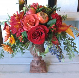 Inexpensive urns filled with fall flowers and little fruits. We found these beautiful leaves in a park.