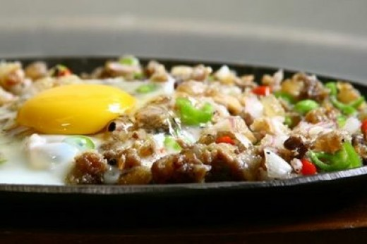 "Another great Filipino treat that goes perfectly with is the palatable ""Sisig""."