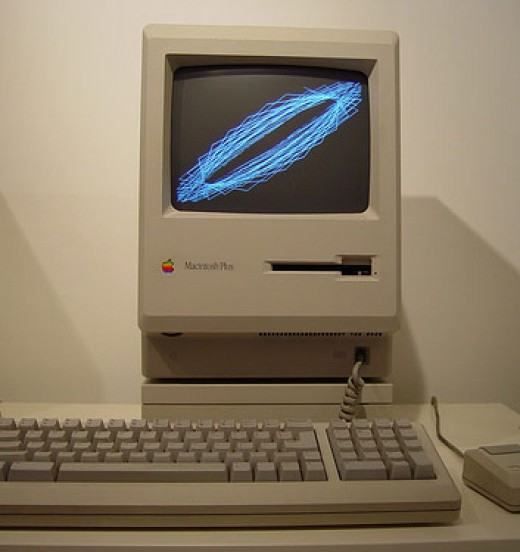 The vintage Mac Plus sitting on its external hard drive.