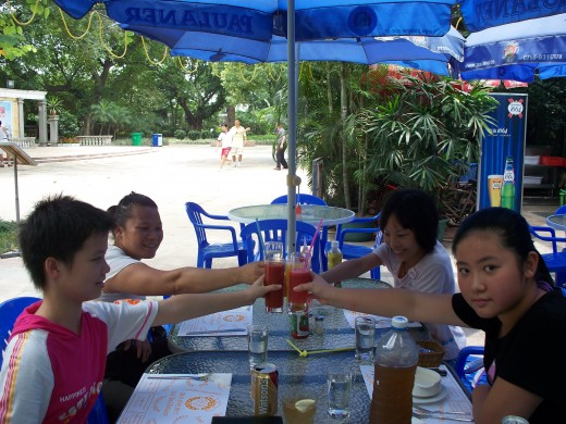 This is a photo of some of my friends experiancing their frisr taste of western food and having a meal at an outdoor cafe. I have many photos of China, Canada, U.S.A  and Mexico
