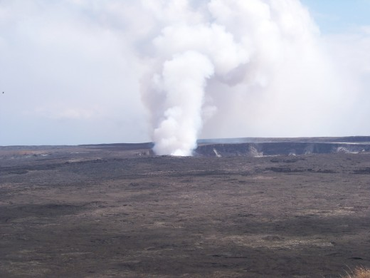 Smoking erupting volcano. To see more pics and videos that we took here  Go to: http://hubpages.com/hub/The-Big-Island-of-Hawaii-Volcano-Pictures-and-Videos