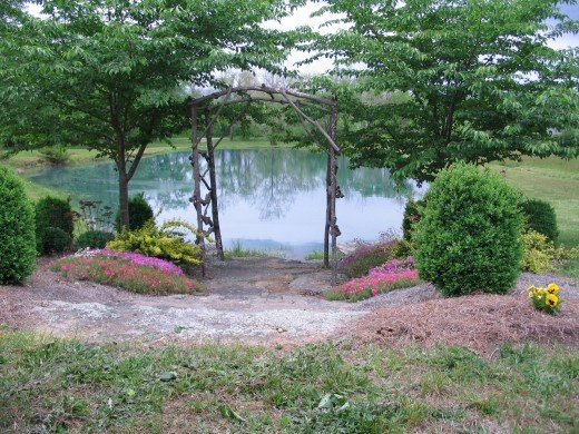 Charming setting with flowering shrubs overlooking the lake at Key Falls Inn.