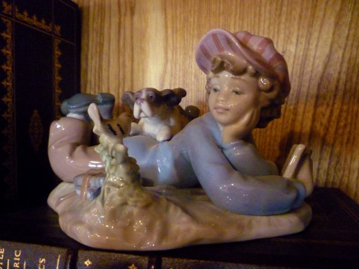 Lladro porcelain with boy, dog and bird