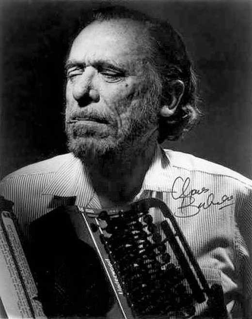 Bukowski with ancient artifact once known as a typewriter