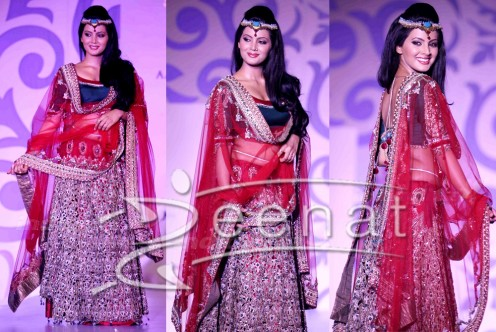 Red with an unusual shade of blue makes a fine bridal lahenga
