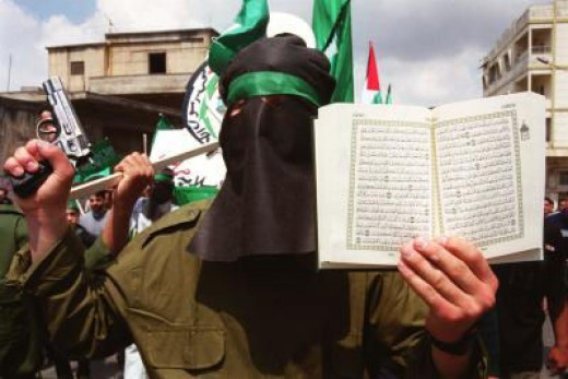 Muslim points to passages in the Koran which allow for the killing of non believers, with his weapon in the other hand.