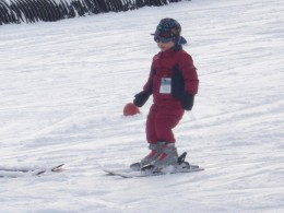 A newly minted three year old on skis