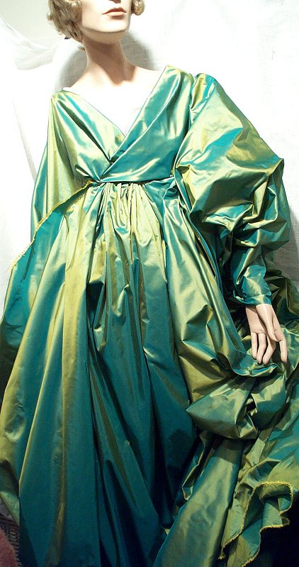 "This beautiful ""gown"" is made from  iridescent green taffeta fabric draped around a mannequin."