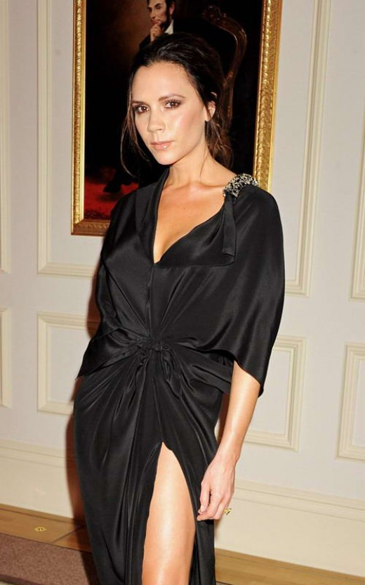 Victoria Beckham here seen wearing a beautiful wrap black dress!