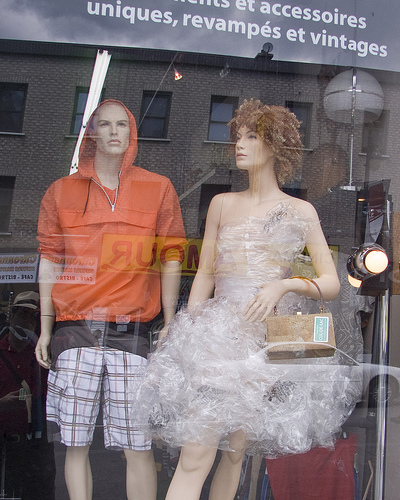 A cling wrap dress in the window of a boutique