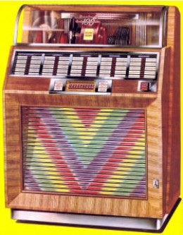 This is a Seeburg Jukebox with a very wild cabinet and grille cloth. This jukebox could play 100 of the new smaller 45 rpm records, that played just long enough for one hit song per side