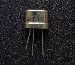 "A 1954 ""Germainimum"" transistor, about 1/2 inch across, so nine of these could fit into a small radio case and run off a single small battery"