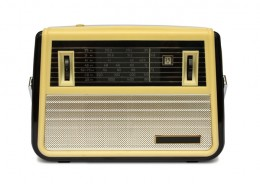 A classic portable, battery powered transistor radio that is ready for a day at the beach