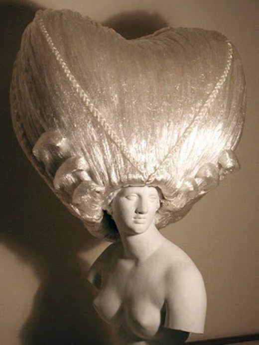 An eccentric cling wrap wig by Kate Cusack