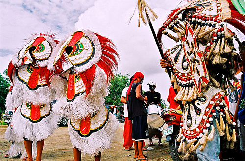 Feathered headdresses and straw skirts are trademarks of the Ati-Atihan Festival in Kalibo, Aklan.